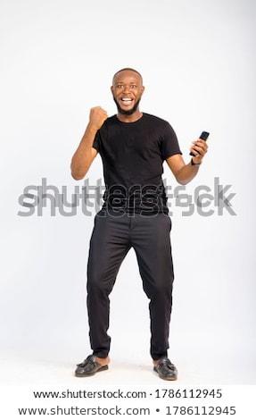 Studio Portrait Of Man With Jubilant Expression Stock photo © HighwayStarz