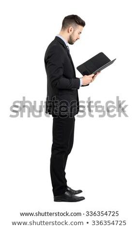 Vista lateral jovem negócio em pé arquivos Foto stock © wavebreak_media