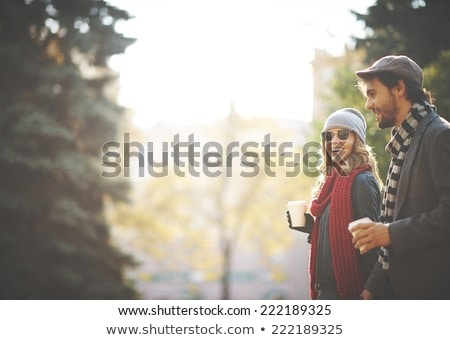 happy young woman drinking coffee in autumn park Stock photo © dolgachov
