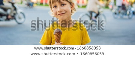 Cute little boy, eating big ice cream in the park, smiling at camera, summertime BANNER, LONG FORMAT Stock photo © galitskaya