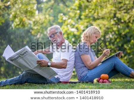Mutlu kıdemli kadın okuma günlük sonbahar Stok fotoğraf © dolgachov