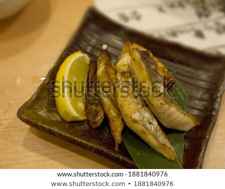 nice slices fish and wooden plate stock photo © ozaiachin