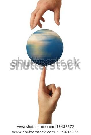 the white mans finger rotates the earth stock photo © cherezoff