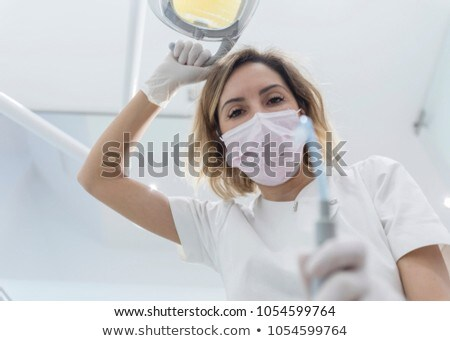 Tandarts assistent patiënt tandheelkundige kliniek Stockfoto © wavebreak_media