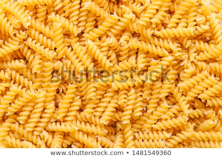 Stock photo: uncooked italian pasta spaghetti and wheat background