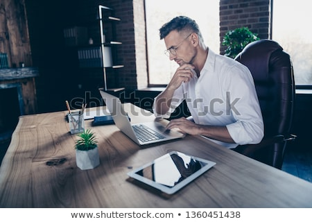 man writing in a notebook sitting in a chair Stock photo © nito