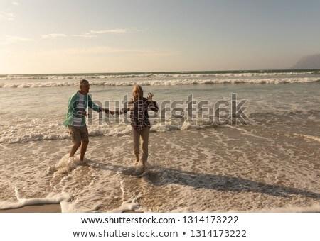 Elöl kilátás aktív idős pár szórakozás tengerpart Stock fotó © wavebreak_media