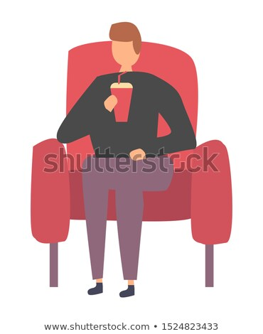 Adam oturma kırmızı koltuk içme soda Stok fotoğraf © robuart