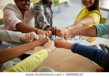 close up of international students hands fist bump Stock photo © dolgachov