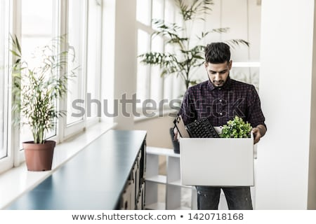 sad fired male office worker with personal stuff Stock photo © dolgachov