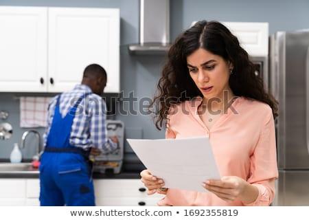 Hayal kırıklığına uğramış kadın bakıyor fatura mutfak Stok fotoğraf © AndreyPopov