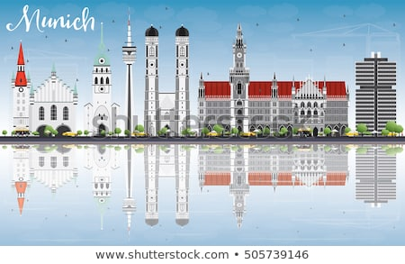 Munich Skyline with Gray Buildings and Blue Sky. Stock photo © ShustrikS