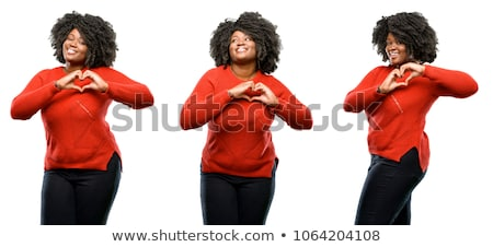 Image of three pretty girls smiling and showing heart shape with Stock photo © deandrobot