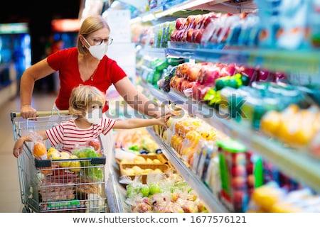Cara da mulher máscara compras legumes supermercado coronavírus Foto stock © Kzenon