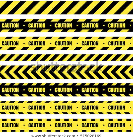 Ostrzeżenie ostrożność taśmy czarny drogowego pracy Zdjęcia stock © SArts
