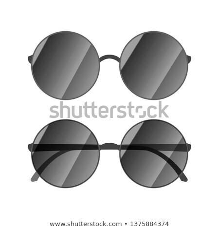 Round glossy sunglasses with black rim on white Stock photo © evgeny89