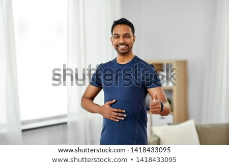 indian man with fitness tracker showing thumbs up Stock photo © dolgachov