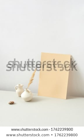 Eco composition from ceramic vases with dry twig and vertical paper sheet. Stock photo © artjazz