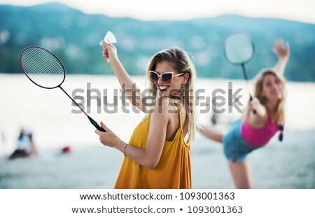 Two Girls Having Fun Playing Badminton Together Stock photo © robuart