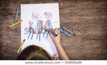 Father and daughter colouring with crayons Stock photo © photography33