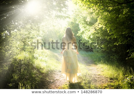 A Beautiful Young Girl Standing On A Forest Path Road Stock photo © ryhor
