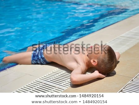 cute handsome teenage boy rests the pool Stock photo © meinzahn