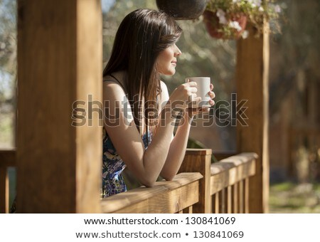 Beautiful young woman relaxing on a log Stock photo © smithore