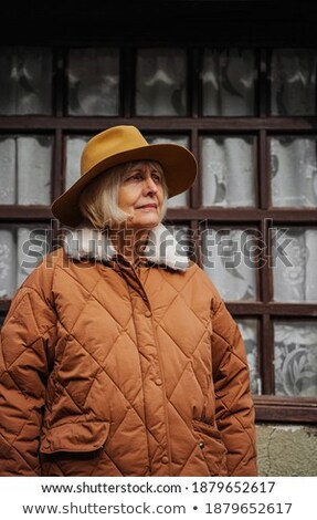 Woman looking away while standing at hut Stock photo © wavebreak_media