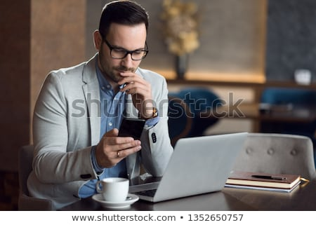 Portrait of a young businessman reading a message on a mobile phone  Stock photo © gravityimaging
