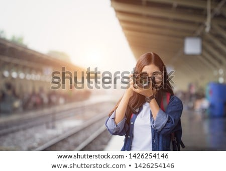 Stock photo: Travel concept. Tourist woman with dslr camera in train.
