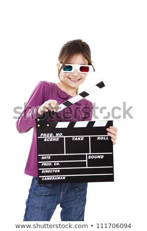 Girl holding clapboard on white background Stock photo © colematt