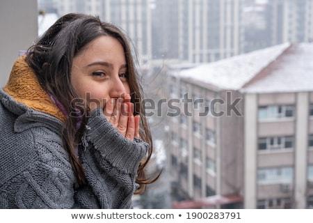 cute girl looking at the cityscape while snowing stock photo © konradbak