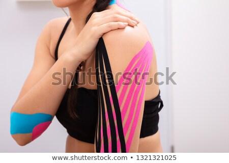 mulher · dor · no · ombro · isolado · branco · mão - foto stock © andreypopov