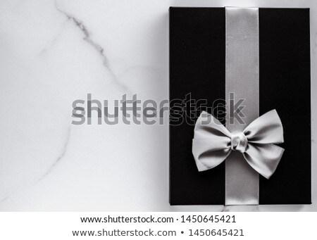 Schwarz Seide Band Bogen Marmor Urlaub Stock foto © Anneleven