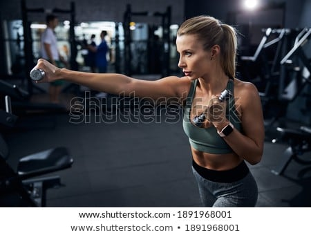 fitness woman doing punching exercises in training place Stock photo © Lopolo