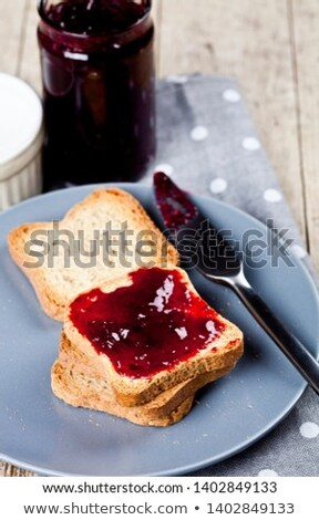 Fresh toasted cereal bread slices on grey plate and jar with hom Stock photo © marylooo