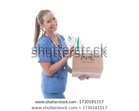 Friendly nurse happy to receive N95 medical mask during pandemic Stock photo © lovleah