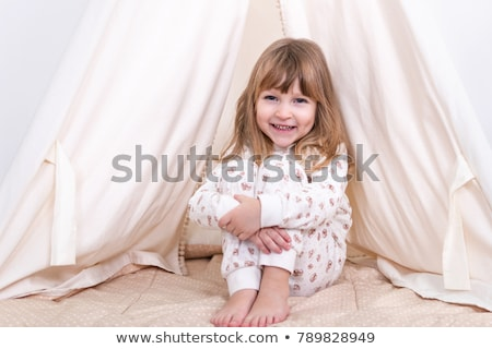 happy girls playing near kids tent at home Stock photo © dolgachov