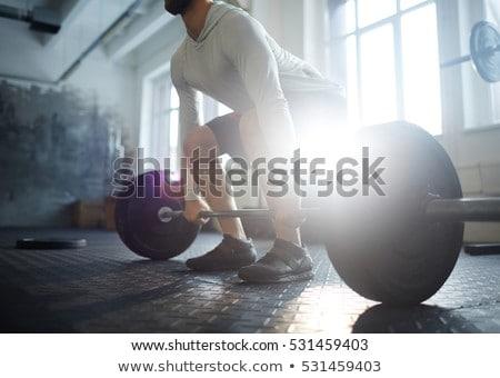 Fitness człowiek podnoszenie ciężarów sztanga kulturystyka zewnątrz Zdjęcia stock © Maridav