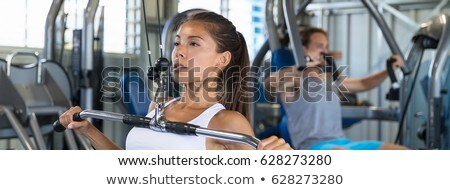 Fitness man strength training cable in gym banner Stock photo © Maridav