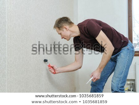 Decorator smoothing wallpaper Stock photo © photography33