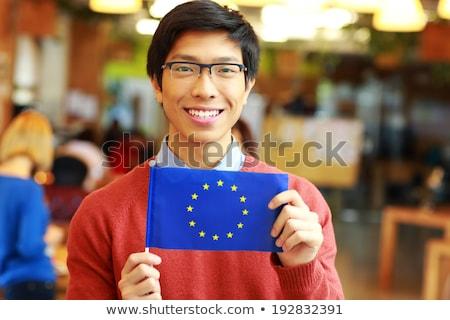 Mutlu genç Asya öğrenci bayrak Stok fotoğraf © deandrobot