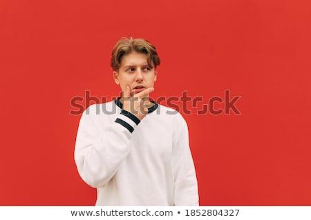 Figyelmes jóképű másfelé néz ujj ajkak fehér Stock fotó © wavebreak_media