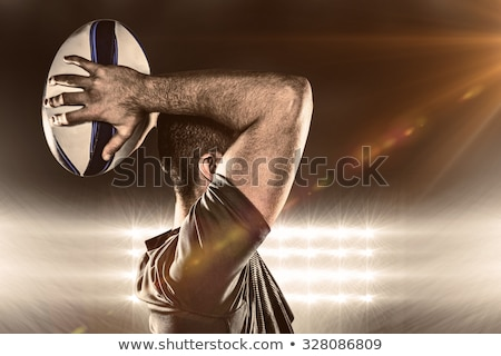 Composite image of rugby player holding the ball stock photo © wavebreak_media