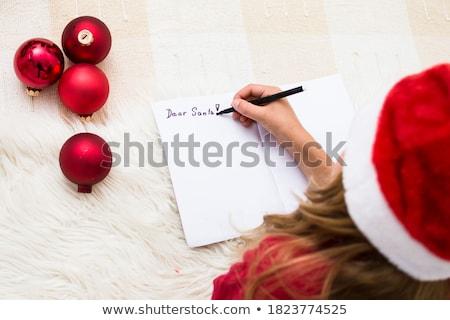 girl writing the letter to santa claus stock photo © choreograph