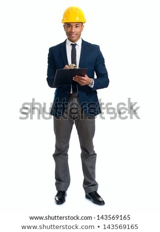 Cheerful young foreman or engineer with clipboard standing in isolation Stock photo © pressmaster