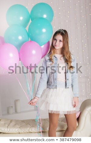 Teenager girl in a pink dress plays with balloons at home in a pink room for children Stock photo © ElenaBatkova