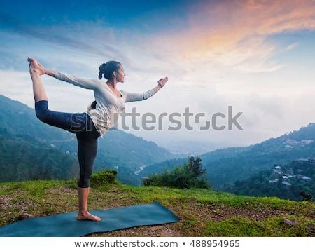 Kobieta jogi odkryty wodospad dance równowagi Zdjęcia stock © dmitry_rukhlenko