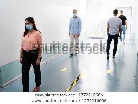 People In Office Following Social Distancing Tape Markings Stock photo © AndreyPopov