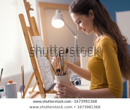 Painter holding her supplies Stock photo © photography33